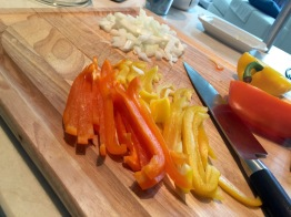 Orange and yellow bell peppers and diced sweet onions
