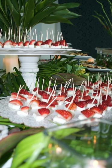 strawberries and fresh mozzarella served alongside balsamic